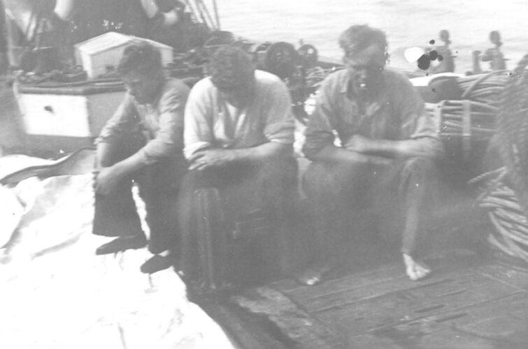 Tre sømænd på dæk